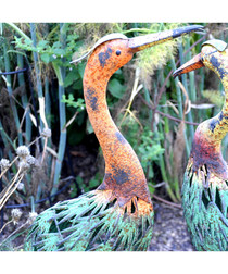 Orange necked metal stork figure