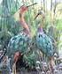 Orange necked metal stork figure Sale - adobe Sale