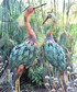 Yellow necked metal stork figure Sale - adobe Sale