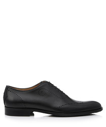 Forate black leather brogues