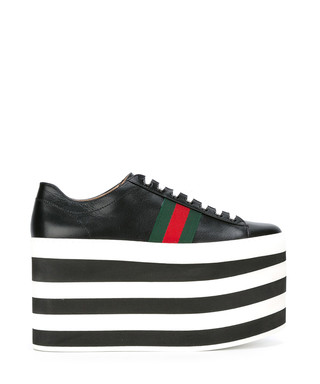 5ac3c8a11cc7 Gucci. Women s black leather platform sneakers