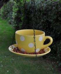 Yellow polka dot tea cup bird feeder
