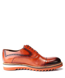 Tan leather statement sole shoes