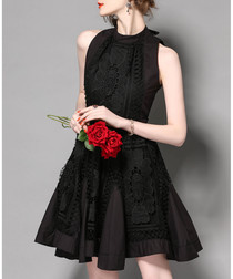 Black sleeveless flared dress