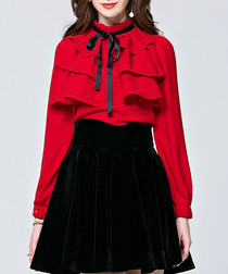 Red tiered long sleeve blouse