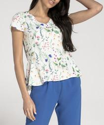 White floral peplum short sleeved top