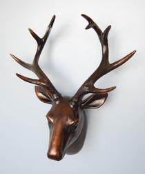 Copper-tone deer head wall decoration