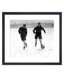 Footballers In Snow, 1930s framed print