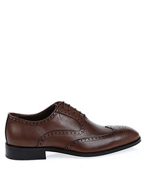 Brown leather punch hole shoes