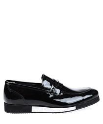 Black & white leather slip ons