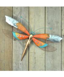 Orange metal dragonfly garden ornament