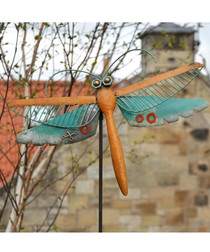 Orange metal dragonfly garden ornament