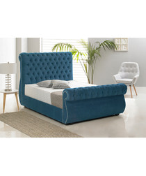 Blue deep buttoned double bed