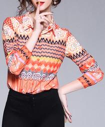 Orange zigzag print button-up shirt