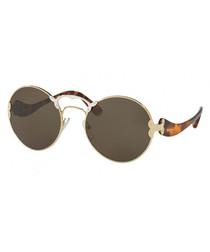 Women's brown Havana round sunglasses
