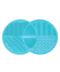 Turquoise silicone brush cleansing tool