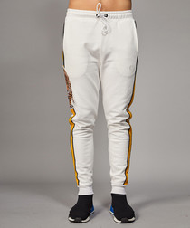 White cotton tiger tape print joggers