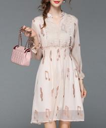 Apricot music note print mini dress