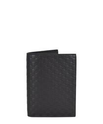 Guccissima black leather passport holder