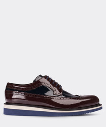 Burgundy patent leather wingtip brogues