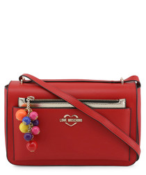Red pompom zip crossbody