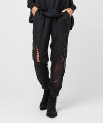Vision jet black ripped trousers