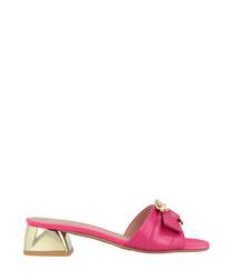 Pink buckle slip-ons